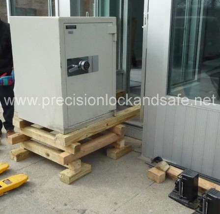 Commercial safe delivery using wood cribbing to bring the safe up steps.